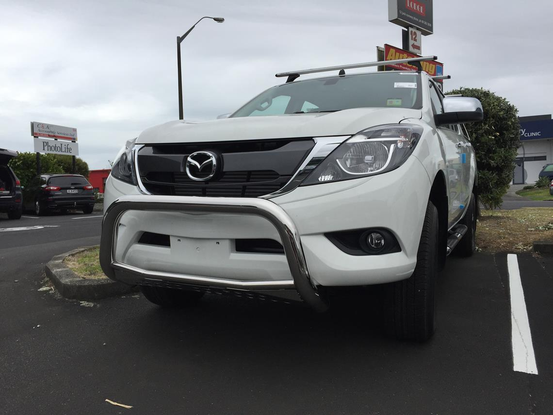 white mazda bt50 with nudge bar