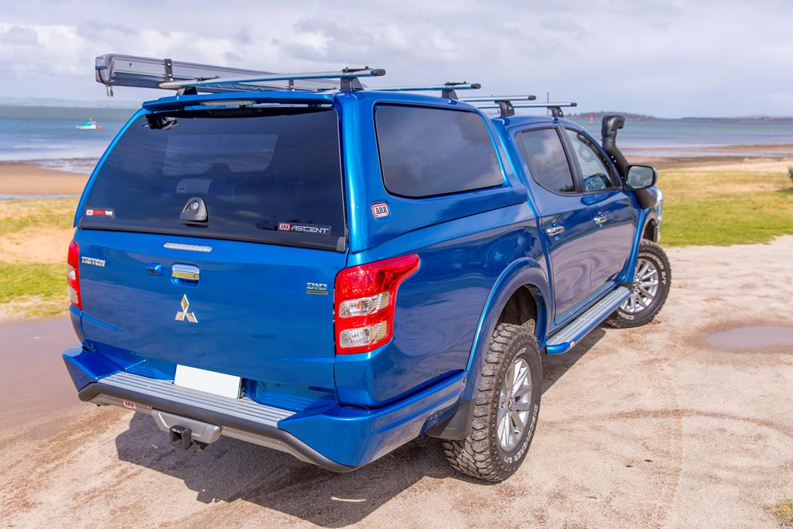 blue mitsubishi triton with arb accessories