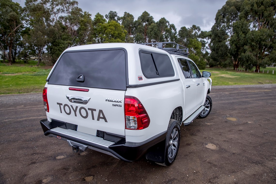 white toyota ute with canopy on back