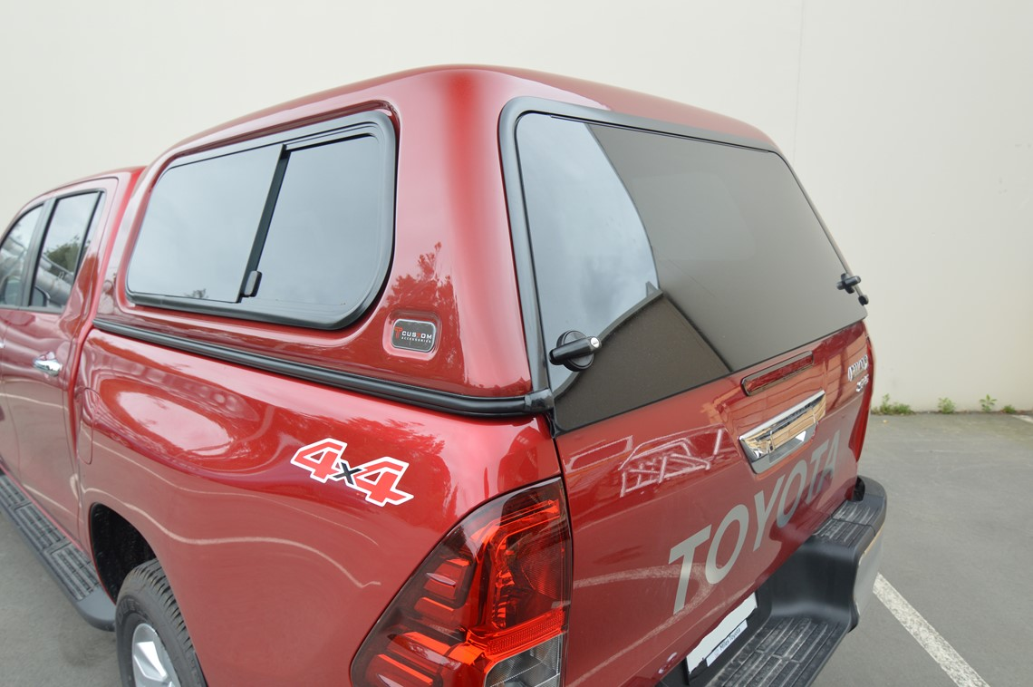 red toyota hilux ute with canopy