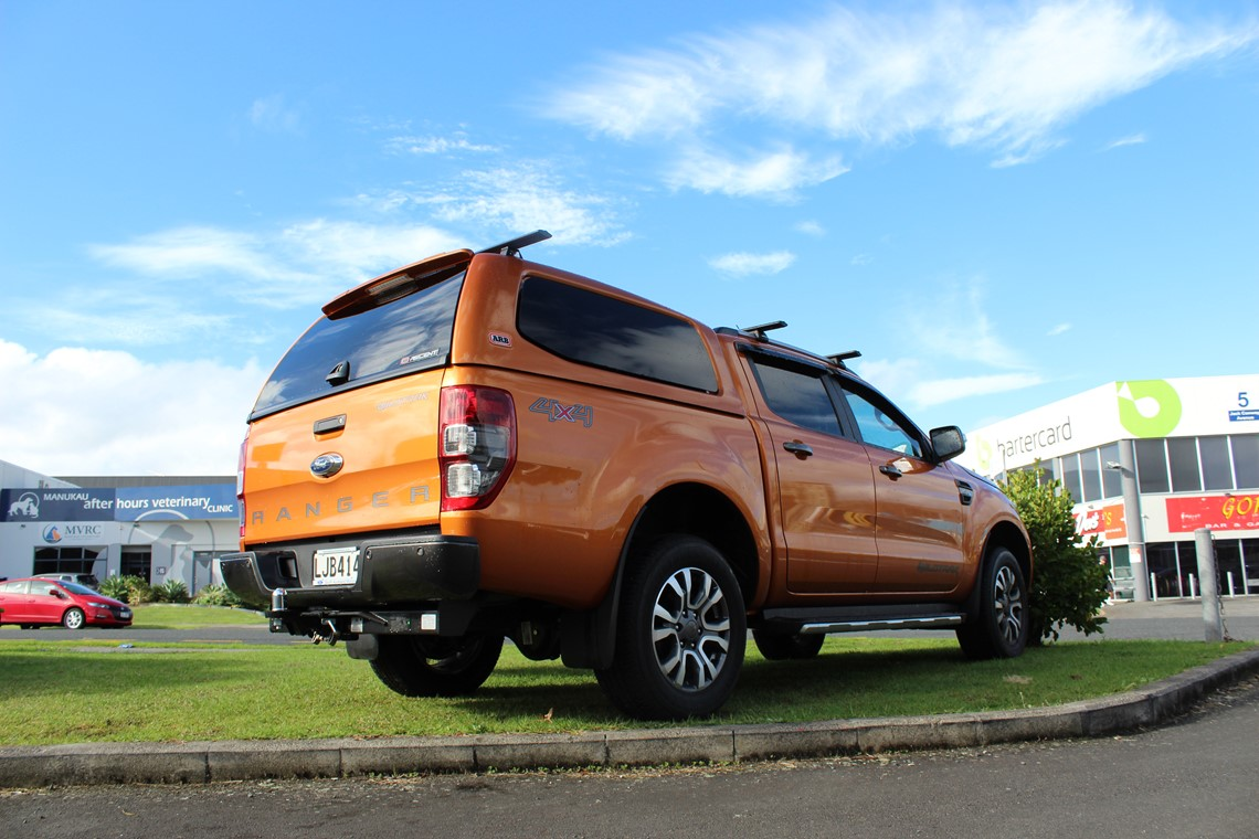 orange ford ranger with canopy