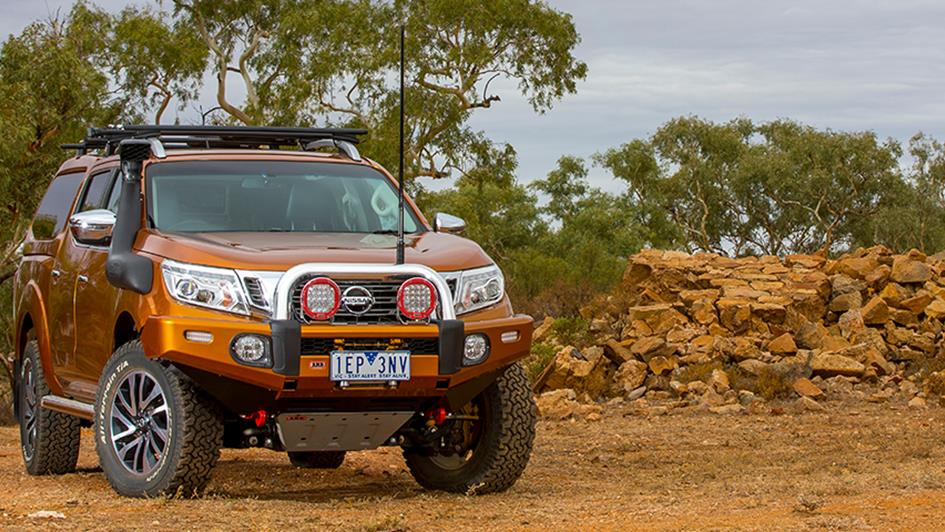 Orange nissan navara with bullbar