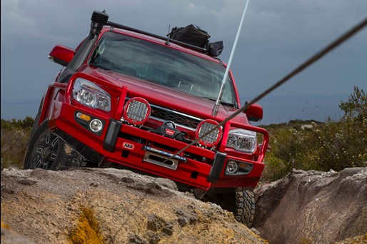 red ute winching over rocks