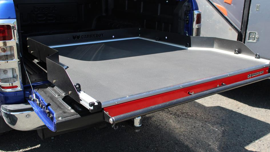 sliding tray in the back of a ute