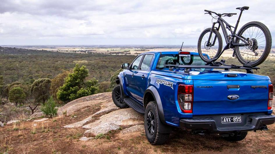 ford ranger raptor with arb plastic ute lid carrying a bike