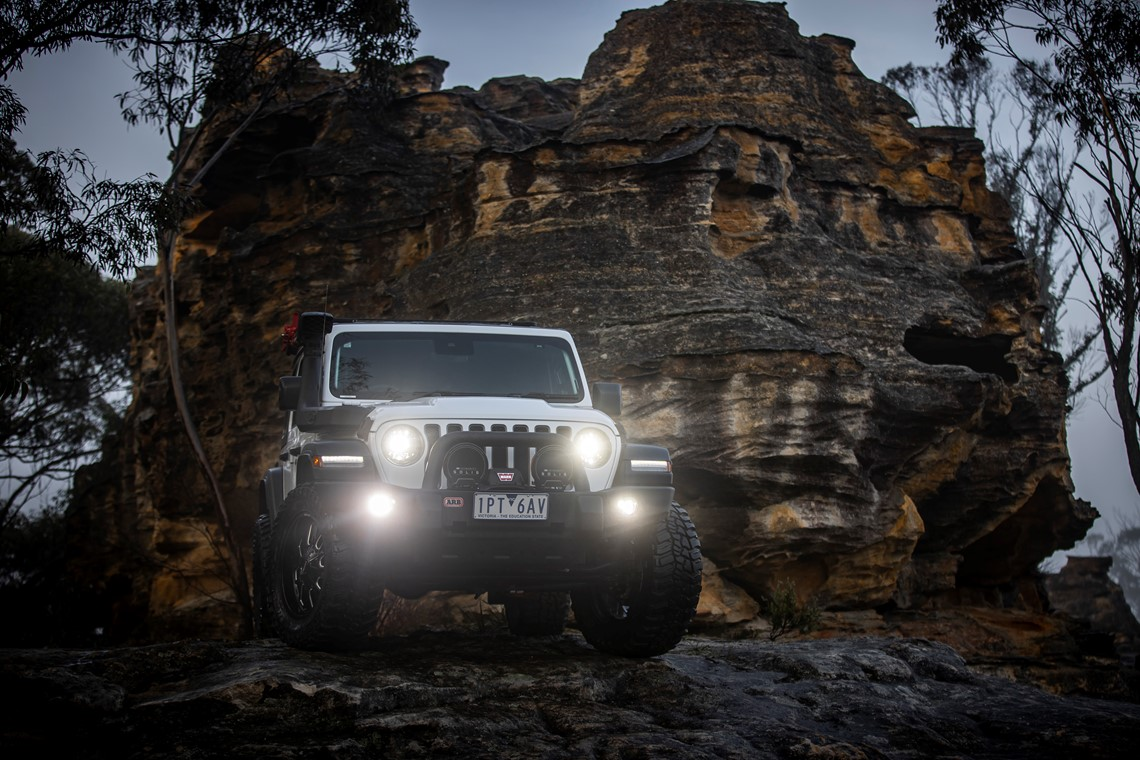 Jeep with spotlights in the dark